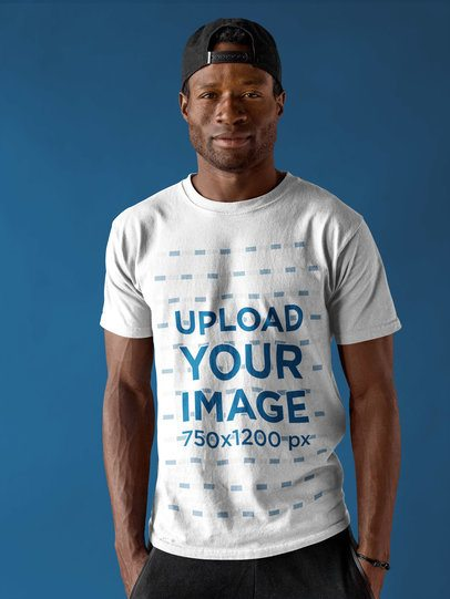 Smiling Black Dude Wearing a Round Neck Tee Template Against a Blue Background a17155