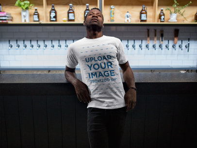 Mockup of a Black Man Wearing a Round Neck Tee While at a Tap Bar a17165