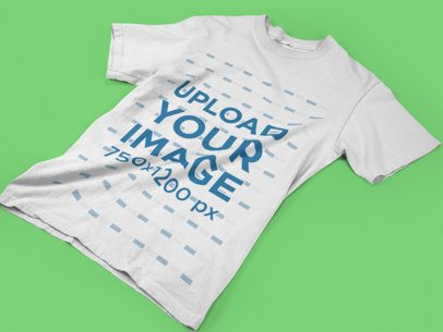 Mockup of a Unisex T-Shirt Lying on a Solid Background a17239