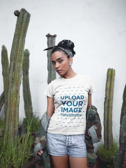 Woman Wearing a Round Neck T-Shirt Mockup While Near Cactus Plants a17209