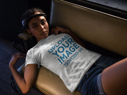 Pretty Woman Wearing a T-Shirt Template While Lying Down on a Sofa a17203