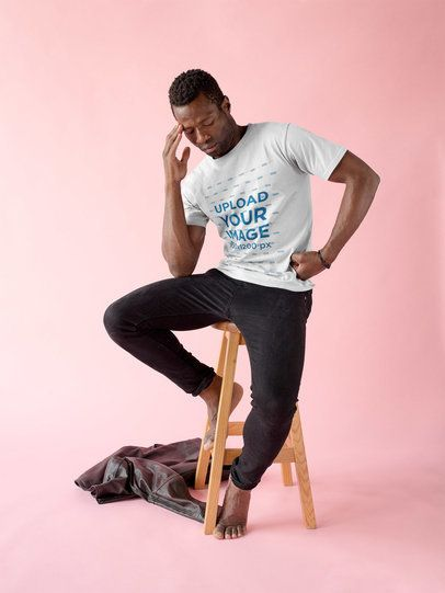 Black Man Wearing a Tshirt Mockup While Thinking on a Bench without Shoes a17158