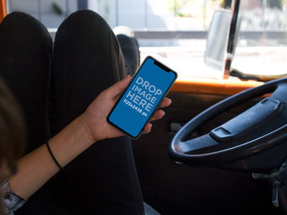 Girl Using an iPhone X Mockup While Inside a Van a17362