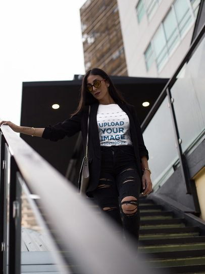 Pretty Fashion Girl Wearing a T-Shirt Mockup While Going Down the Stairs a17247