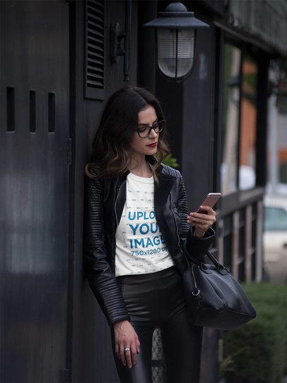 Pretty Fashion Girl Calling a Cab While Wearing a Tshirt Mockup a17358