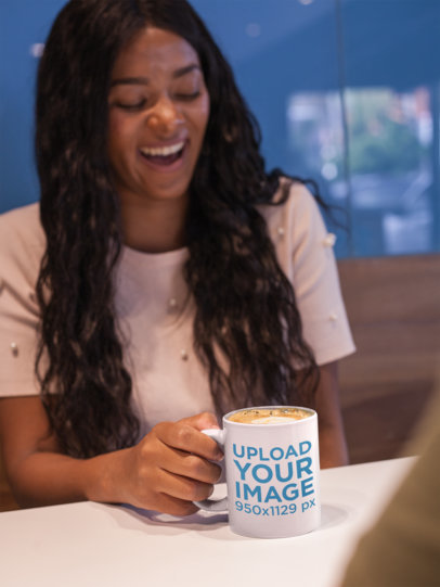 Happy Girl Holding a Coffee Cup Mockup in a Coffee Shop a17338
