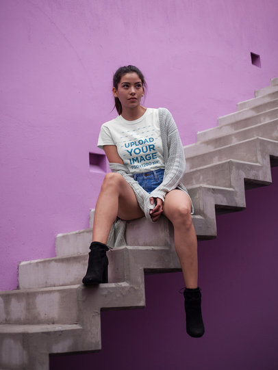 Asian Girl Sitting on Stairways Wearing a Tshirt Mockup a17475