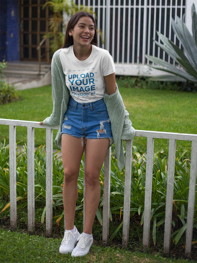 Happy Beautiful Girl Wearing a Round Neck Tee Mockup in her Garden a17467