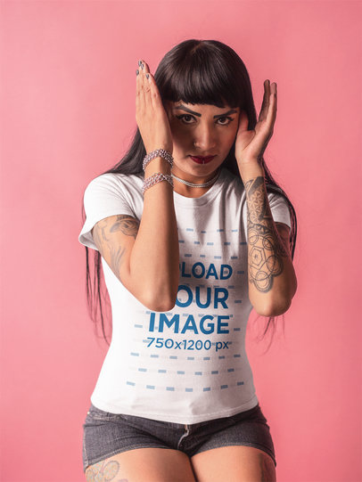 Tattooed Girl Wearing a Tshirt Mockup Covering her Face in the Studio a17146