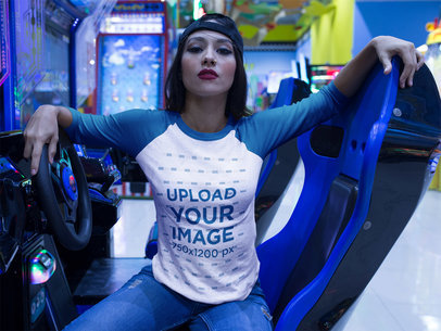 Girl with an Attitude Wearing a Raglan Tee Mockup Sitting in a Racing Simulator a17515