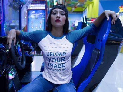 Girl with an Attitude Wearing a Raglan Tee Mockup Sitting in a Racing Simulator a17515
