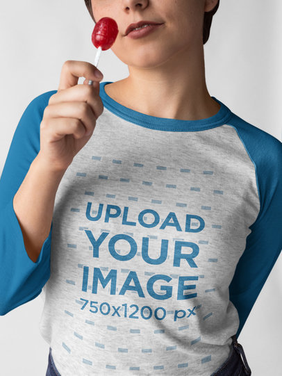 Girl Wearing a Raglan Tee Template while Holding a Lollipop a17526