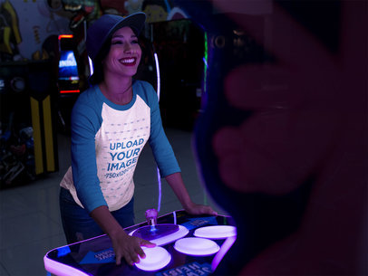 Beautiful Girl Wearing a Tshirt Mockup While Playing an Arcade Game a17520