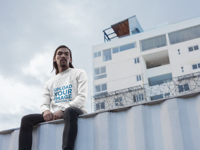 Asian Bearded Man Wearing a Crew Neck Sweatshirt Template While on Top of a Container a17587