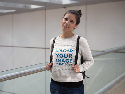 Smiling Girl with Backpack Wearing a Crewneck Sweatshirt Template at the Airport a17631