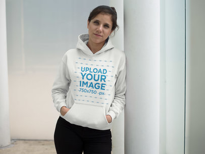 Girl Wearing a Pullover Hoodie Mockup While Lying Against a Metal Column a17635