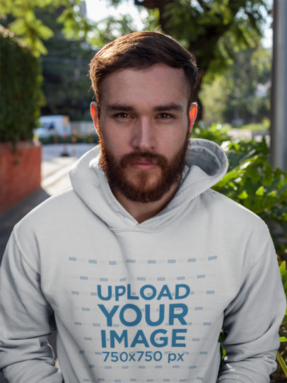 Red Head Man Wearing a Pullover Hoodie Mockup While on the Street a17733