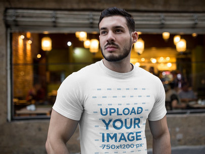 Buff Dude Wearing a Tshirt Mockup while Near a Cafe a17685
