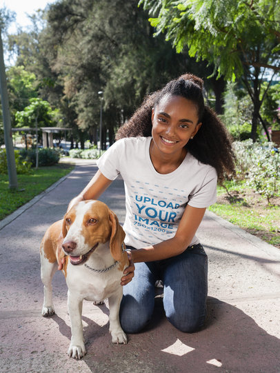Black Girl with a Dog Wearing a T-Shirt Mockup at the Park a17838