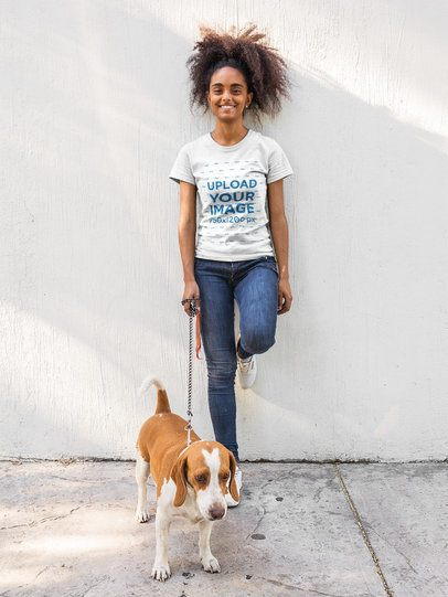 Girl with Curly Hair Wearing a T-Shirt Mockup while Walking her Dog a17842