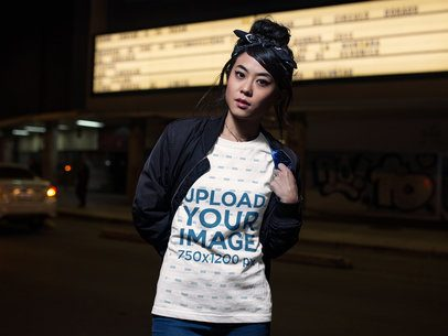 Asian Girl Wearing a Tshirt Mockup While on the Street at Night a17784