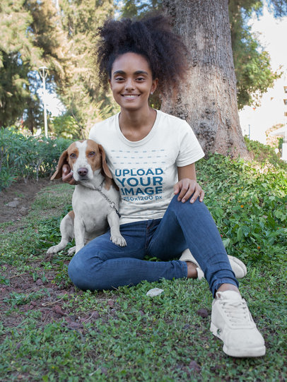 Smiling Girl Wearing a T-Shirt Mockup while with her Dog at the Park a17841