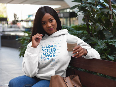 Pretty Black Girl Having a Coffee While Wearing a Pullover Hoodie Mockup a17746