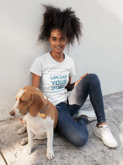Pretty Black Girl Wearing a T-Shirt Template While Sitting on the Street with her Dog a17846