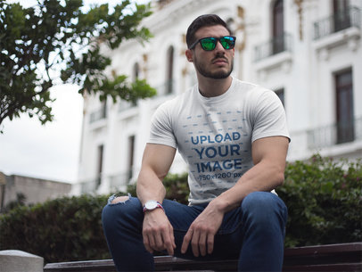 Buff Guy Wearing a Tshirt Mockup While Sitting  a17683