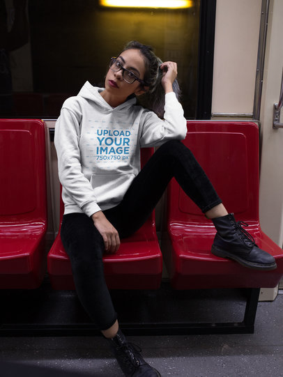 Hipster Girl Wearing a Pullover Hoodie Mockup While in the Metro a17643