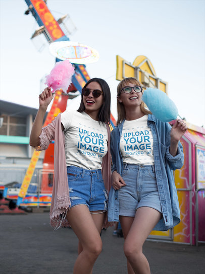 Friends Wearing T-Shirts Mockup While Eating Cotton Candy at a Carnival a17887