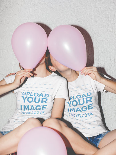 Two Girls Hiding Behind Pink Balloons Wearing Tshirt Mockups a17965