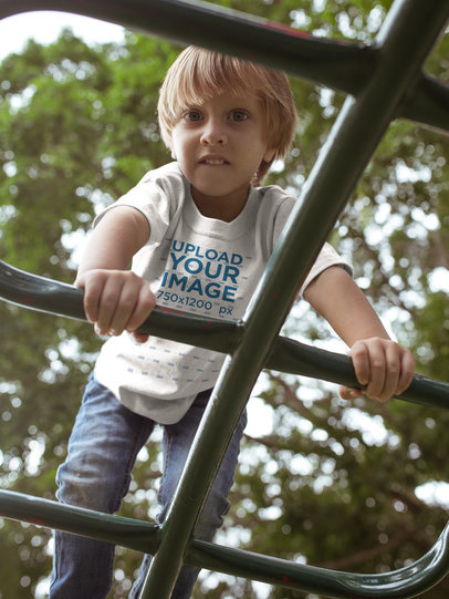 Boy Climbing Wearing a T-Shirt Mockup a17949