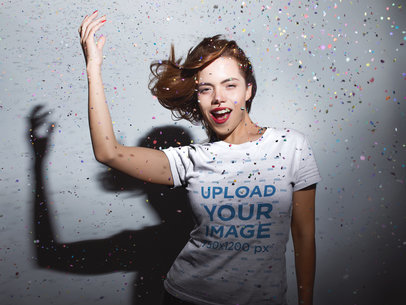 Redhaired Woman Wearing a Tshirt Mockup while Under a Confetti Rain a18018