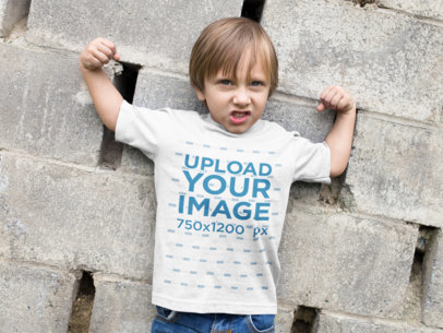 Little Boy Wearing a T-Shirt Mockup while Raising his Arms a17943