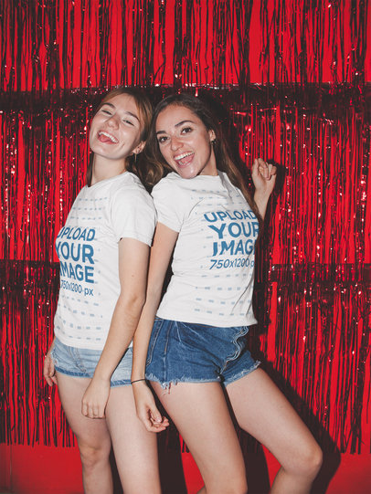 Mockup of Two Friends Wearing Tees in Front of a Shimmering Curtain 17968