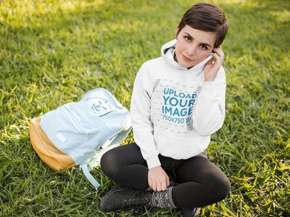 Student Girl Wearing a Pullover Hoodie Mockup While at a Park a17927