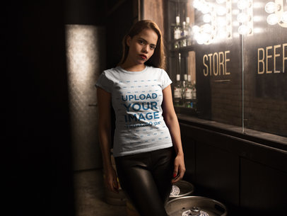 T-Shirt Mockup of a Girl at a Bar with Dim Light 17991