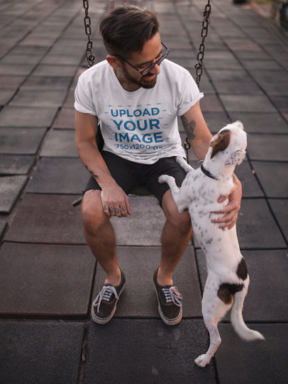 T-Shirt Mockup of a Man Petting His Dog at a Playground 18029