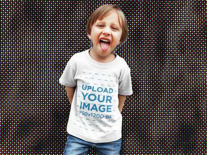 White Boy Making a Funny Face Wearing a Tshirt Mockup Against a Big Screen a17946