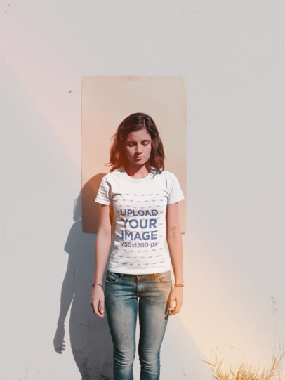 Girl Wearing a Tshirt Mockup Standing Against a Cardboard on a Wall a18479