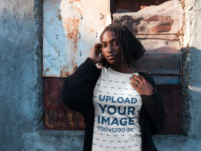 Black Girl Wearing a Round Neck Tee Mockup While Against a Broken Window a18564
