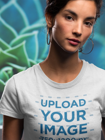 Front Shot Mockup of a Woman Wearing a Tshirt Against a Blue Flower Background a18591