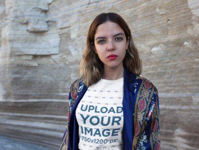 Girl Looking at the Camera Wearing a Tshirt Mockup Outdoors a18568