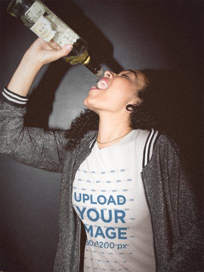 Woman Drinking Rum Wearing a T-Shirt Mockup at the Bar a18816