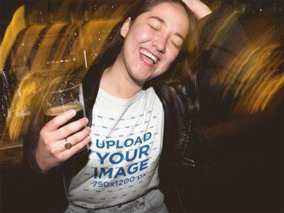 Happy Girl at a Party Wearing a Tshirt Mockup at Night a18853