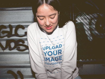 Shy Asian Girl Wearing a Crewneck Sweater Mockup at Night a18851