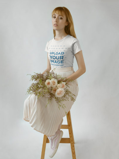 Girl Wearing a Round Neck T-Shirt Mockup while Holding Flowers on her Lap a18362