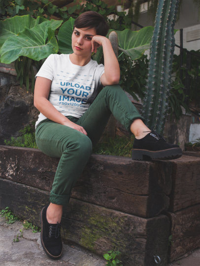 Mockup of a Girl Relaxing Near Cactus and Plants Wearing a T-Shirt a18441