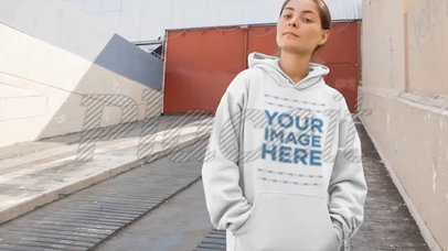 Woman Wearing a Pullover Hoodie Video Mockup on an Industrial Ramp a13110